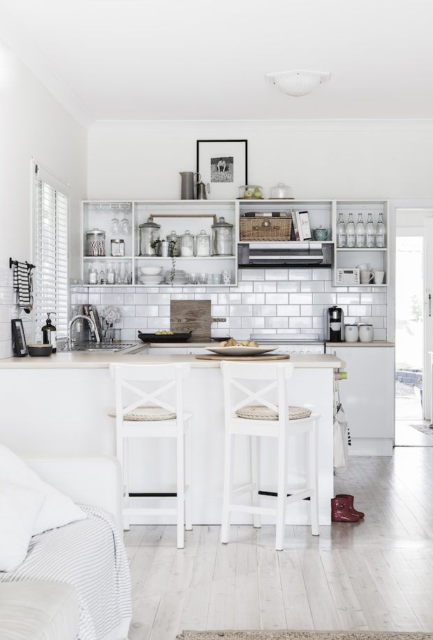White and neutral kitchen in a pared-back Australian home. Photographer: Maree Homer.