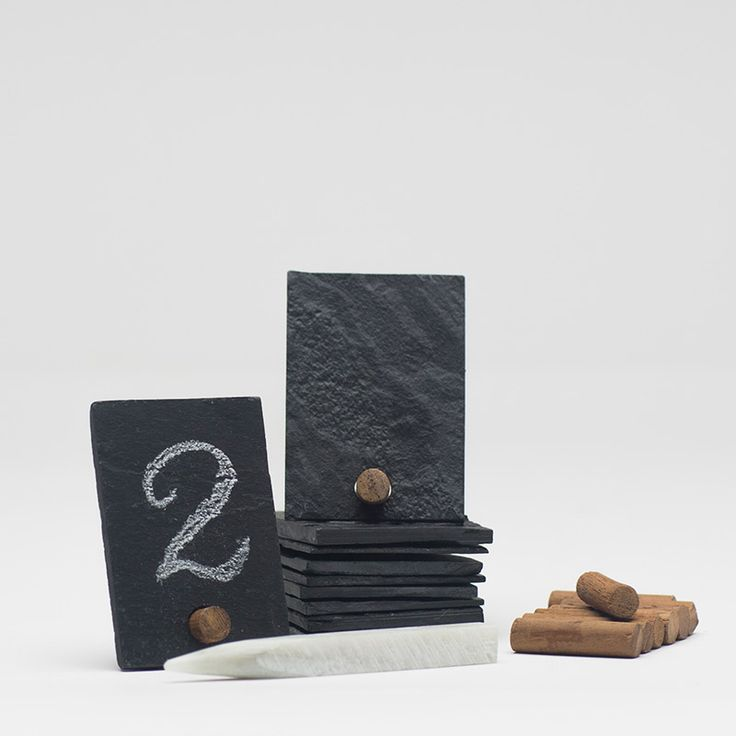 This set of ten slate cards offers a clever way to number tables or assign seats.  The set includes a soap stone which makes writing and erasing easy and small wooden pegs that allow the cards to stand. They are perfect as place cards or as labels for cheeses, sauces, and other food items.  www.pressedcotton.com