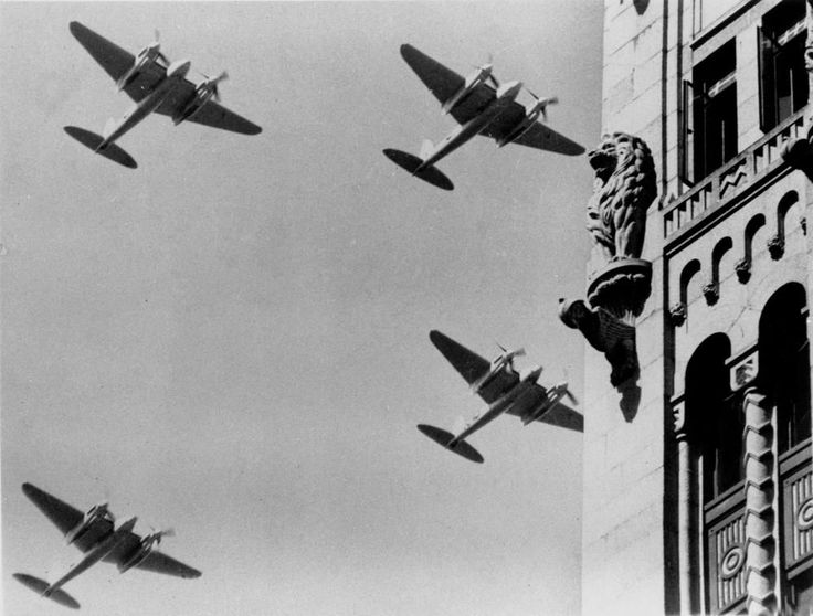 Royal Australian Air Force (R.A.A.F.) Mosquito bombers over Brisbane, Australia, ca. 1945