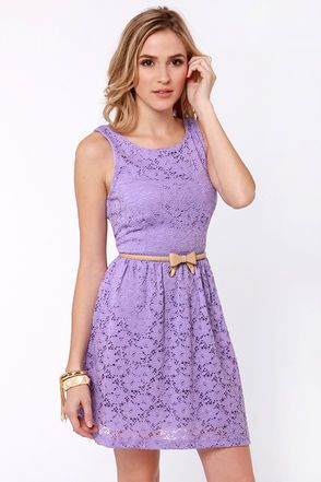 """With stretchy knit lace and a versatile skater dress design, the Birthday Party Lavender Lace Dress really takes the cake! A darted tank bodice dips into a modest v-back, while the flattering boat neckline and full skirt are singing happy birthday to you! Invisible back zipper. Belt not included. Fully lined. Model is wearing a size small. Small measures 34"""" long. 22"""" waist. 30"""" bust. Shell: 95% Nylon, 5% Spandex. Polyester lining. Dry Clean Only. Made with Love in the U.S.A."""