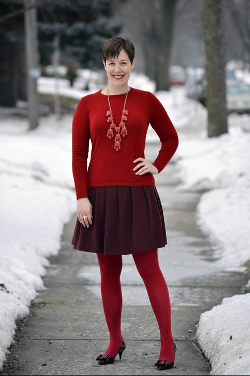 Already Pretty outfit featuring red crewneck sweater, burgundy pleated skirt, red tights, burgundy bow pumps, bubble necklace