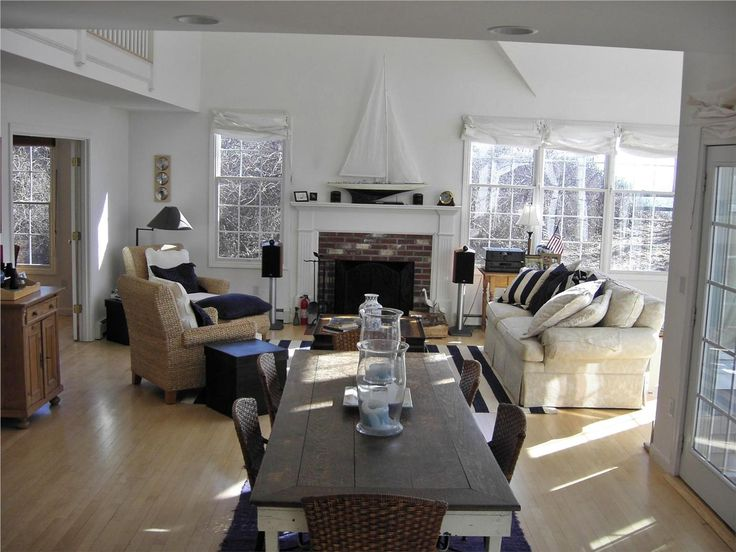 A Very Cape Cod Living/dining Area. Love The Boat On The Mantle.