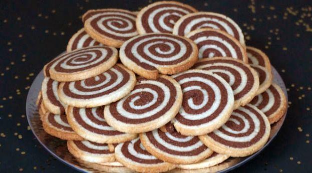 Voici une bonne recette et surtout très jolie! Sablé spirale vanille et chocolat qui fond en bouche. C'est à préparer pour offrir avec amour à vos proches