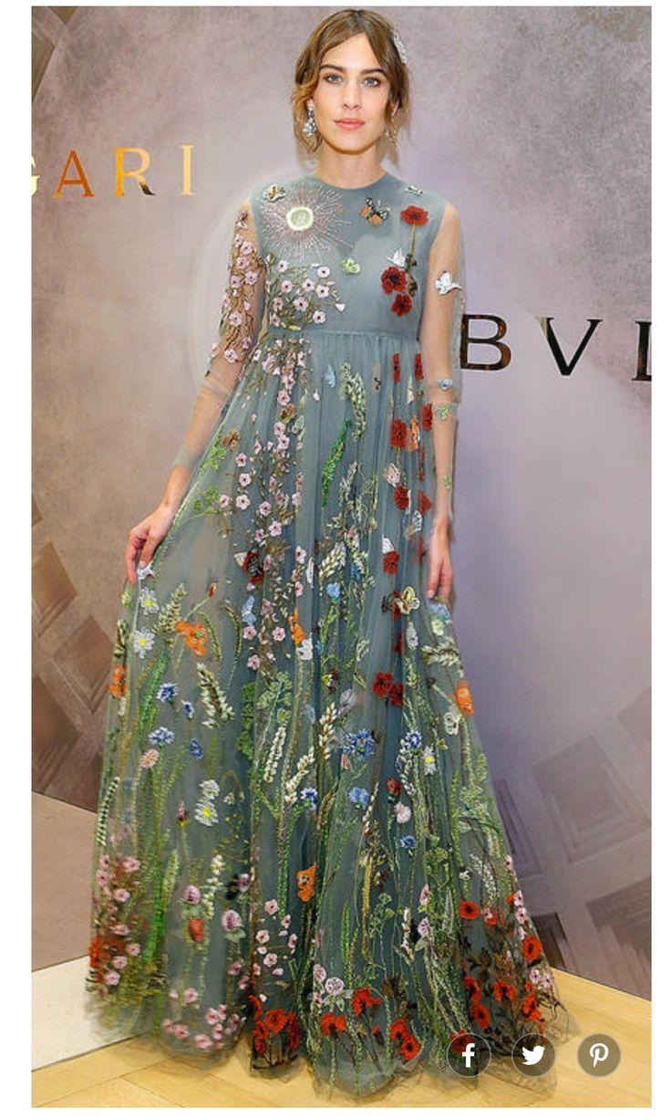 Incredible fabric, beautiful woman, ugly dress.