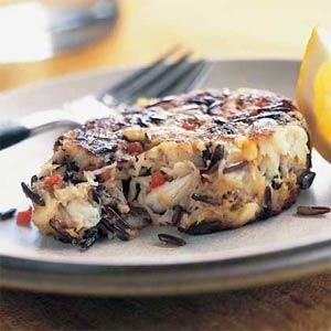 The addition of cumin to these hearty crab cakes enhances the nuttiness of the wild rice. If you want to top them with a sauce, combine light mayonnaise with lemon juice and a pinch of curry powder. Serve these with lemon wedges.
