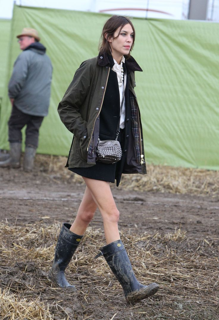 Alexa Chung in Barbour jacket, Pamela Love necklace, Superga wellies, and Burberry bag