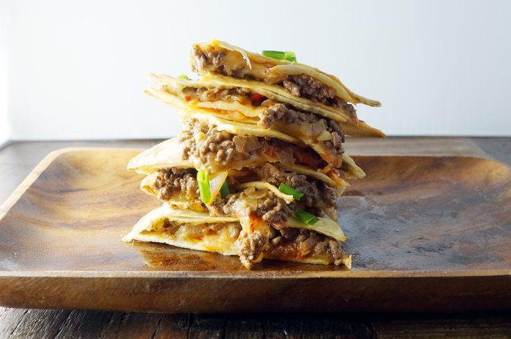 Korean Beef Quesadillas - spicy Korean beef, crisp kimchi, and gooey cheese melt and ooze together between inside a warm tortilla