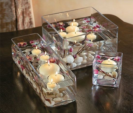 floating candle with the orchids for a unique asian centerpiece. Would be great with bamboo too!