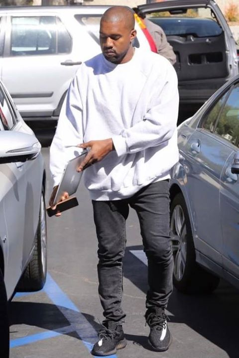 Kanye West spotted wearing new striped Yeezy Boost 350's. What do you think?  http://ift.tt/1Xb93dy
