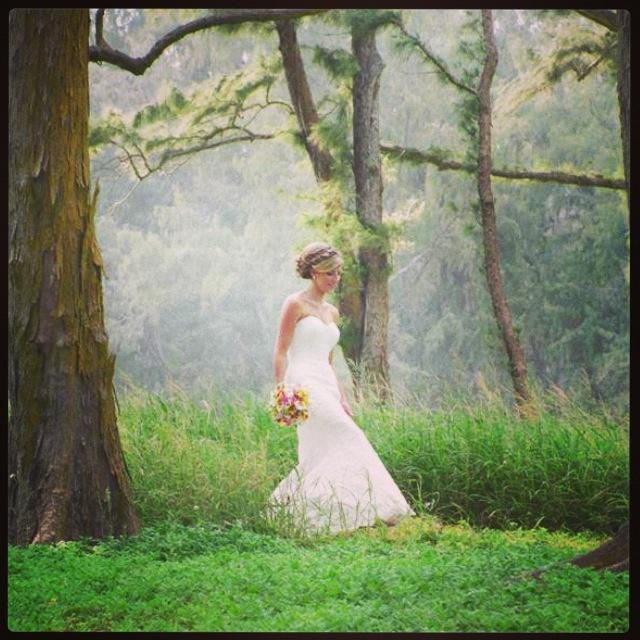 Bride walking through the forest toward Waimanalo Beach in Hawaii. #bride #photography #beachwedding