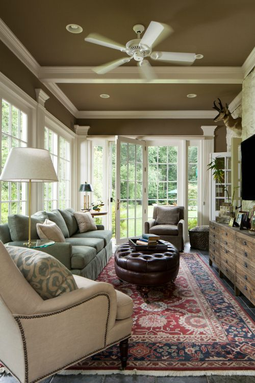 nice rich color on the ceiling and the little bit above the windows really anchors this room well with all the windows. Dilwyne Designs - sunroom