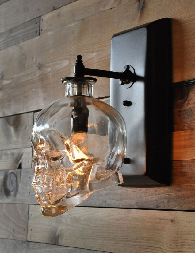 Recycle an empty crystal head vodka skull bottle into a wall sconce. #lighting