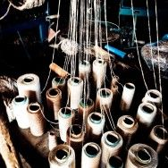 Plying a carpet size thread, at Shuttleworth Weaving, Mooi River, KZN, South AFrica