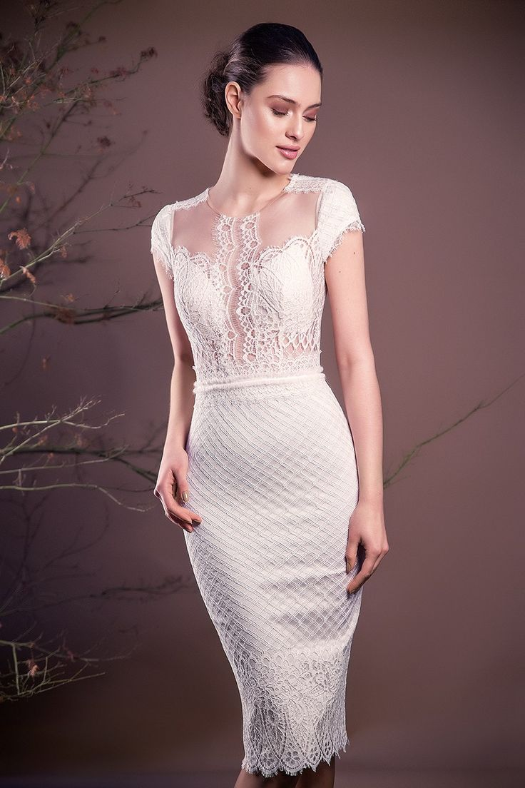 CRISTALLINI SKA642 - A mix of Chantilly lace, cut-inspiring sites and a perfect bodycon silhouette, classic cocktail dress that turns into a definition of modern bride.  Mid lenght wedding dress French Chantilly lace bust 100% Italian tulle polyamide bust Chantilly lace pencil skirt and waistband, french Soieries Chambutaires stretch satin lining for added comfort Mid length Hidden YKK back zip, hook and fastening, pearl button Incorporated push-up bra cups for support Dry clean For...