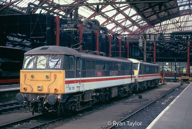 86216 (ex E3166) at Liverpool Lime Street on 16th Aug 1996. Built by English Electric at the Vulcan Foundry, entering traffic on 27th September 1965. Named 'Meteor' on 31st Aug 1979. Withdrawn in April 1998 . After spending almost five years dumped at Willesden, Glasgow works and Immingham Railfreight Terminal it was broken up by Easco, on site at Immingham in March 2003.