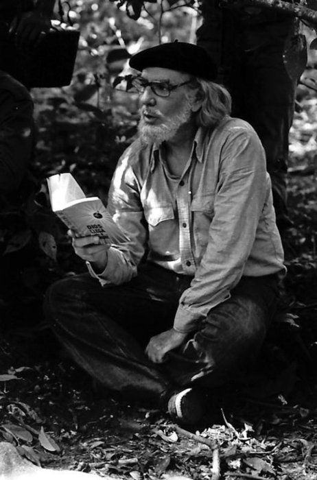 """Nicaragua's famous priest and poet, Ernesto Cardenal, reading to Sandinista guerrillas in the mountains."" c. 1978."