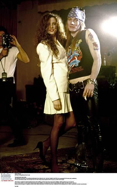 "Axl Rose of Guns N' Roses, and his wife Erin Invicta Everly during the making of ""Sweet child o' mine"",late '80s"