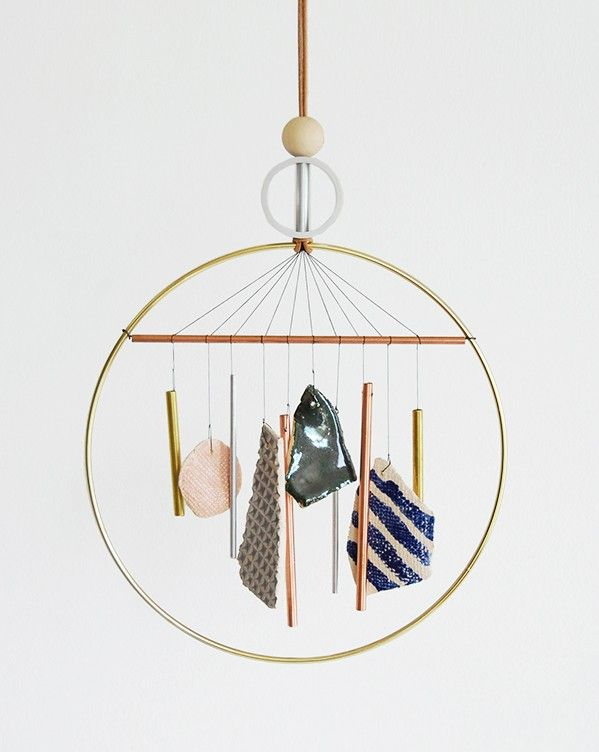 this is a wind chime i would LOVE in my home. it's stylish and modern.