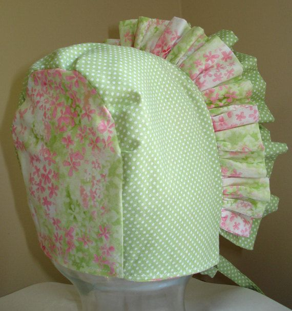 This soft green and pale pink bonnet is just what you need to keep your little ones head protected and to add the most adorable accent to her already adorable face. Her little face will be surrounded by ruffles and miniature flowers....what could be cuter! I made this bonnet with a double ruffle which allows the ruffles to stand up and add to its total cuteness. I used all cotton fabrics to keep it baby friendly. You will get double duty from this fully reversible bonnet- soft green and pink…