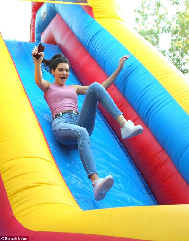 Thrill-seeker: Kendall Jenner tried out the huge inflatable slide at the party organised t...