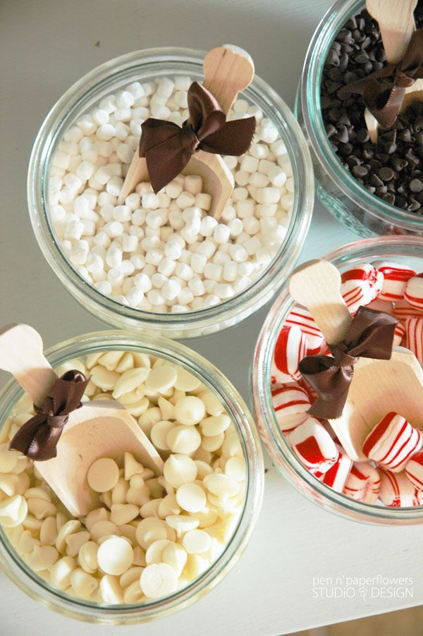 Hot Cocoa Bar Need: Mom's carafe, hot cocoa options, marshmallows, peppermint sticks, white chocolate Me: hot chocolate - party favors Katie: marshmellows