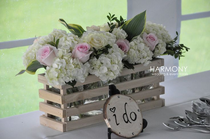 Rustic wooden box with fresh lush flowers