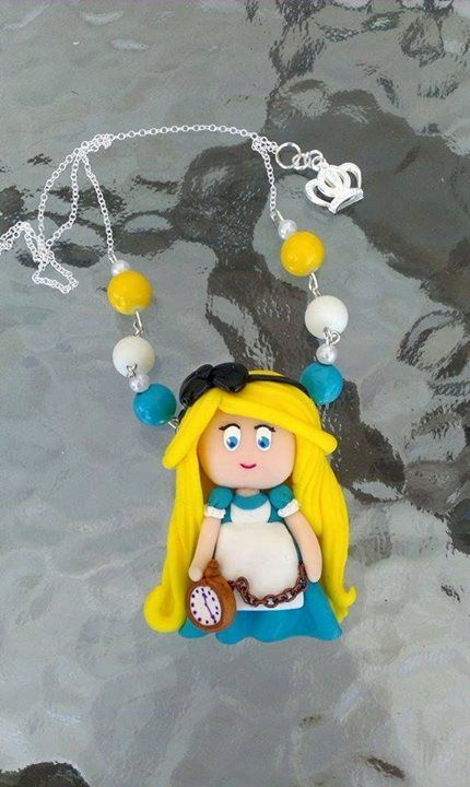 #Alice #clay #necklace  Made out of polymer clay one of our favorite Disney characters now comes to life!  Alice in Wonderland Necklace is 100% Handmade item!  She is wearing her beautiful blue dress with a white apron and she is holding the rabbit's ( that she so desire to catch ) pocket watch!  Alice is coming on a Sterling Silver Plated chain with matching beads with her colors and also the Queens Crown on it!  A great gift for you or your loved ones who likes Alice!