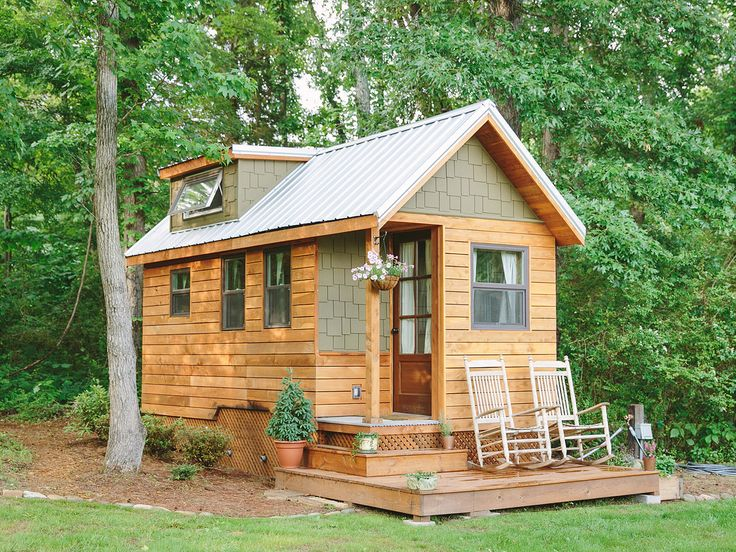 """The 204-square-foot """"Wind River Bungalow"""" is the Chattanooga, Tennessee, home of tiny house enthusiasts Travis and Brittany Pyke, who started Wind River Custom Homes to help others fulfill their dreams of living simply in mini dream homes. Constructed of rain-screen cedar and hardy siding for extreme durability, the bungalow is full of custom features, including a pine and cedar interior, polymer concrete counters, and a loft ladder integrated into the shelving system.   - CountryLiving.com"""