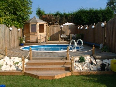 15 39 round above ground pool in decking outdoors for Above ground pool decks for small yards