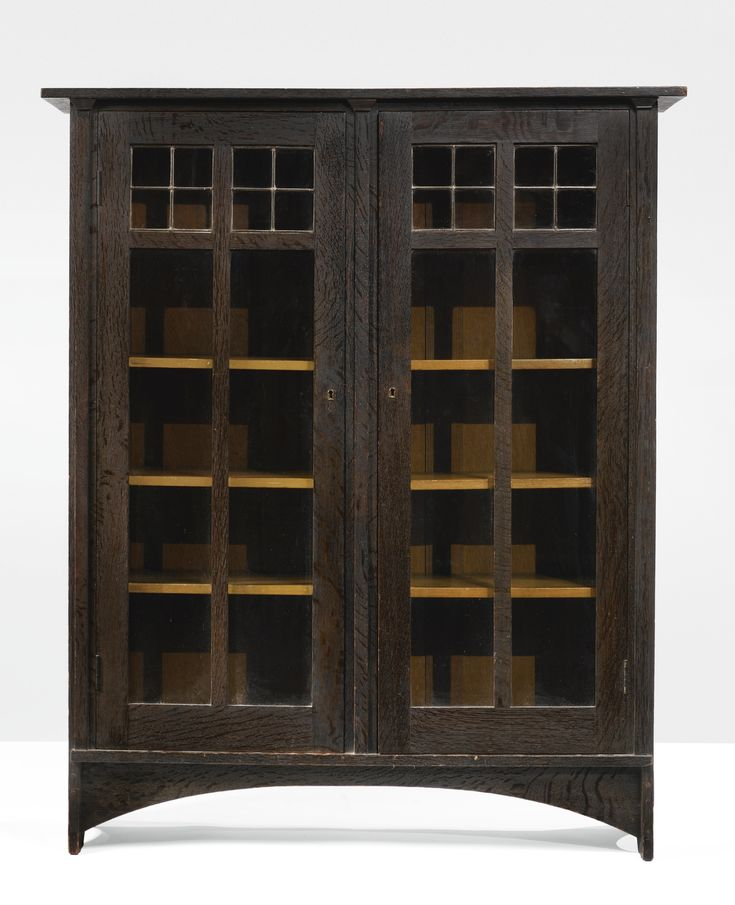 GUSTAV STICKLEY TWO-DOOR BOOKCASE designed by Harvey Ellis executed by the Craftsman Workshops of Gustav Stickley, Eastwood, NY with firm's ...