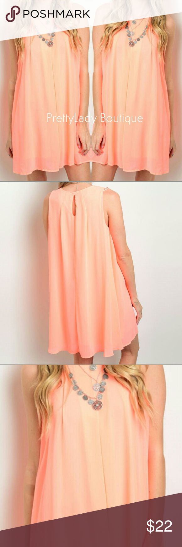 Neon Coral dress This sleeveless woven dress features a round neckline, flowy fit and full lining. Such a soft dress, small peep hole on back. Simple and cute! ✨Fabric: 100% POLYESTER ✨Beautiful color  ✨Firm Price ✨Dress approx 32in long Dresses