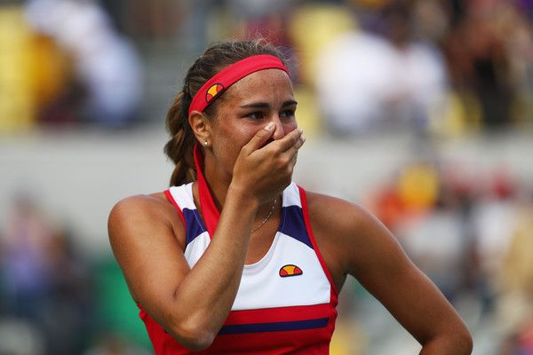 Monica Puig Photos - Monica Puig of Puerto Rico reacts after defeating Petra Kvitova of the Czech Republic during the Women's Singles Semifinal on Day 7 of the Rio 2016 Olympic Games at the Olympic Tennis Centre on August 12, 2016 in Rio de Janeiro, Brazil. - Tennis - Olympics: Day 7
