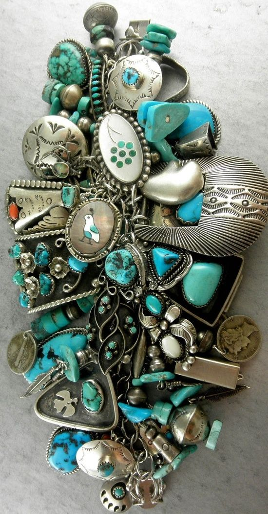 Bracelet with 56 charms | Charms include those made by Ester White (Navajo), Lolita Platero (Zuni), Helen Long (Navajo), Alberto Contreras (Navajo), Jim Paywa (Zuni) plus many more Bracelet and most of the charms are sterling silver. Predominately turquoise with the occasional coral piece incorporated into a charm. by Jio