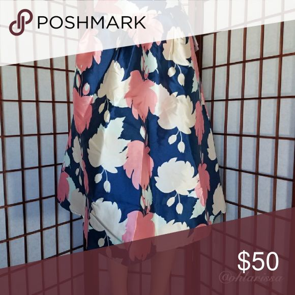 AJ Hollywood Skirt - Navy Floral This versatile fun skirt is can br styled with a t-shirt to dress down for a more everyday use. This beauty has pockets! Every skirt should have pockets! My Amelia James Skirts Circle & Skater