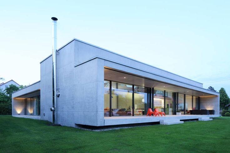 Nowoczesny dom parterowy z płaskim dachem, którego wnętrza…