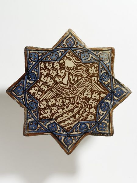 Tile Place of origin: Kashan, Iran (probably, made) Date: early 14th century (made) Artist/Maker: unknown (production) Materials and Techniques: Fritware, glazed and painted in cobalt blue and lustre Museum number: 1493E-1876