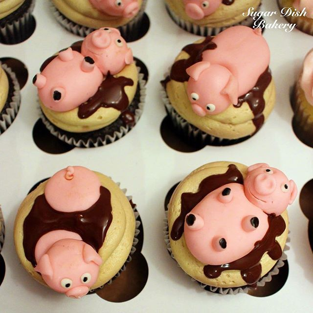 So stinking cute! Chocolate espresso bean cupcakes topped with handmade and edible piggies! I love the story behind these - made for an engagement party for the groom who insists on having a whole roasted pig at his wedding reception. Smart guy! #cupcakes #cupcakestagram #instacupcakes #piggy #piggies #pig #pork #pigroast #foodie #yum #nom #wedding #sahm #mompreneur #espresso #coffee #edible #edibleart
