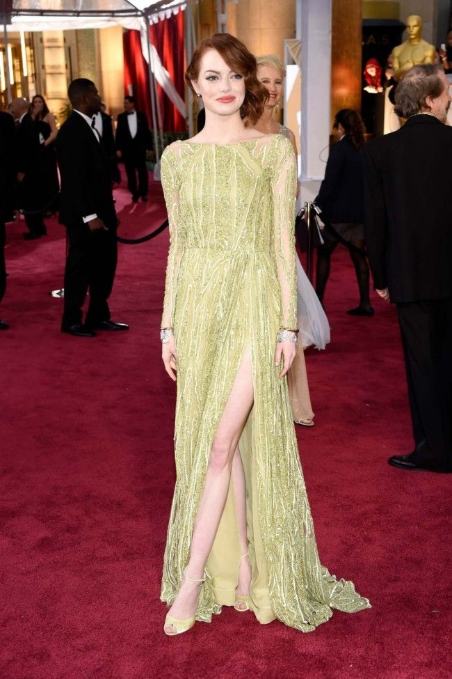87th Academy Awards: Oscars 2015 red carpet : Emma Stone in an Elie Saab dress, Christian Louboutin shoes and Tiffany and Co jewellery