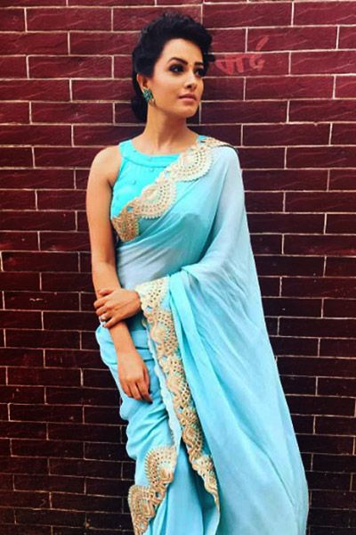 Anita Hassanandani wears an angelic off shoulder white blouse and makes a style statement.