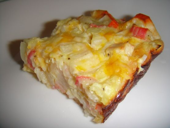 Crab (imitation) quiche  This is a lowfat, delicious quiche! I am always asked for this recipe (I serve often at brunches). Can be made ahead And baked next day, and/or frozen. Leftovers are wonderful when warmed in microwave and placed on toasted english muffin. My 2 year-old loves it too. NOTE: Do not use real crab meat; it will not come out the same.