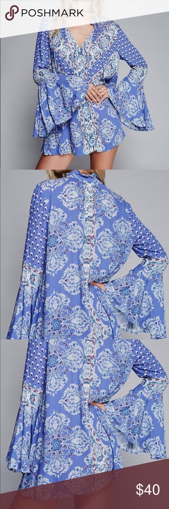 Magic Mystery Dress Printed mini with v neckline and ruffled collar. Long sleeves with flared cuffs. By Free People. This is a new dress just don't have tags. Color: Sky Blue  Fabric: Rayon  Style Number: Ob539806_S Free People Dresses Mini