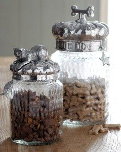 "Arthur Court | These attractive treat jars are made of glass with lustrous cast aluminum lids that require no polishing. From Arthur Court. Imported. * Cat treat jar is 5""Dia. x 9""T $65. * Dog treat jar is 6""Dia. x 13""T; holds 2.25 quarts. N/A"