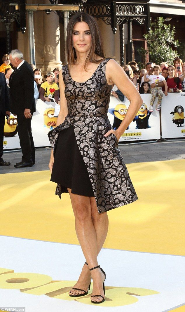 A new life:Two weeks ago Bullock revealed to People that she had adopted a three-year-old daughter. 'My family is blended and diverse, nutty, and loving and understanding,; she told the publication. 'That's a family'; here she is seen in June at the Minions premiere