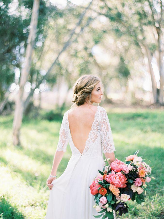 Open back romantic lace wedding dress: http://www.stylemepretty.com/california-weddings/san-diego/la-jolla-san-diego/2016/03/29/colorful-spring-bridal-session/ | Photography: Natalie Bray - http://nataliebray.com/