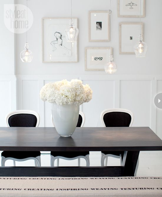 Design studio: Dining area featuring gallery wall and reupholstered pinstripe denim dining chairs {PHOTO: Janis Nicolay}