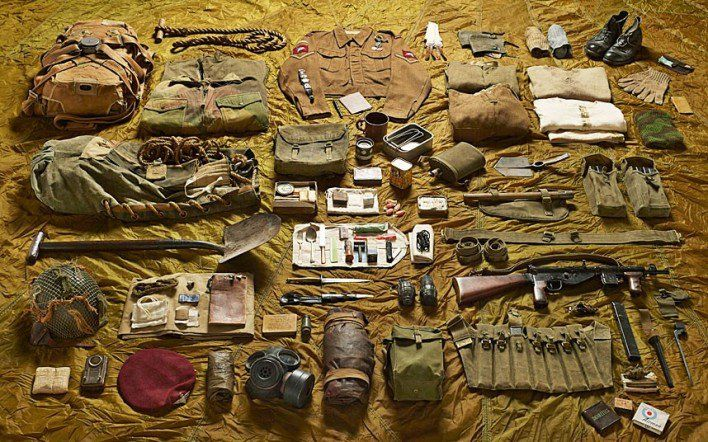 1944 lance corporal, Parachute Brigade, Battle of Arnhem  Each photograph shows a soldier's world condensed into a pared-down manifest of defences, provisions and distractions. There is the formal (as issued by the quartermaster and armourer) and the personal (timepieces, crucifixes, combs and shaving brushes).