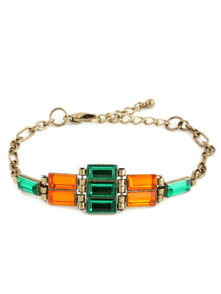 This striking bracelet rocks a pretty simple silhouette, but it manages to evoke both subtle tribal graphics and all-out glamour. And you can't go wrong with that lavish array of two-tone emerald-cut jewels.