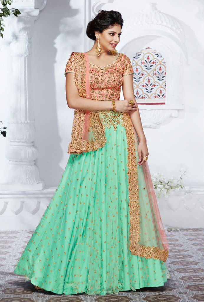 Featuring peach and pista green designer party wear lehenga set with embroidery on top and bottom. It comes with peach dupatta. TOP: Net, dhupian, silk BOTTOM: