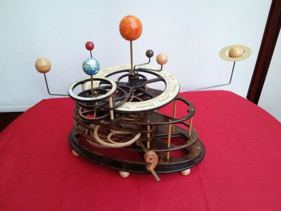 Wooden six planet working orrery solar system model.