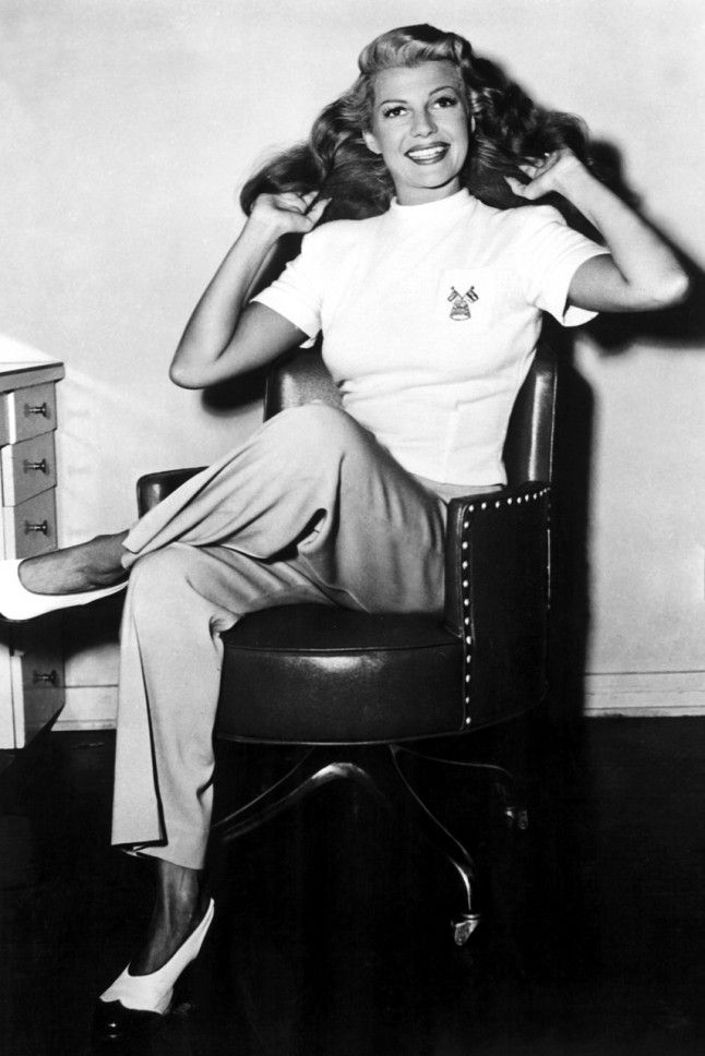 1940. Rita Hayworth, The actress embraces androgynous style in a pair of wide-legged trousers and monochrome flats. - Marie Claire, UK